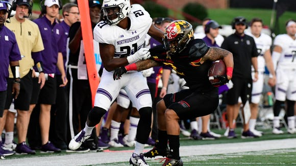 Oct 14, 2017; College Park, MD, USA; Northwestern Wildcats safety Kyle Queiro (21) pulls down Maryland Terrapins running back Lorenzo Harrison III (2) during the third quarter at Maryland Stadium. Northwestern Wildcats defeated Maryland Terrapins 37-21. Mandatory Credit: Tommy Gilligan-USA TODAY Sports