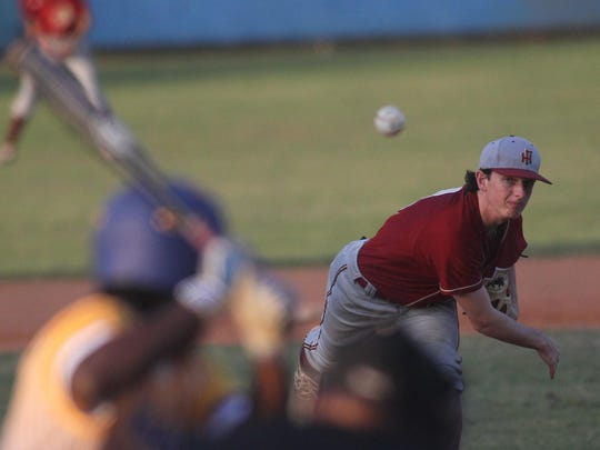Florida High's Brandon Mitchell pitches during a recent game against Rickards.