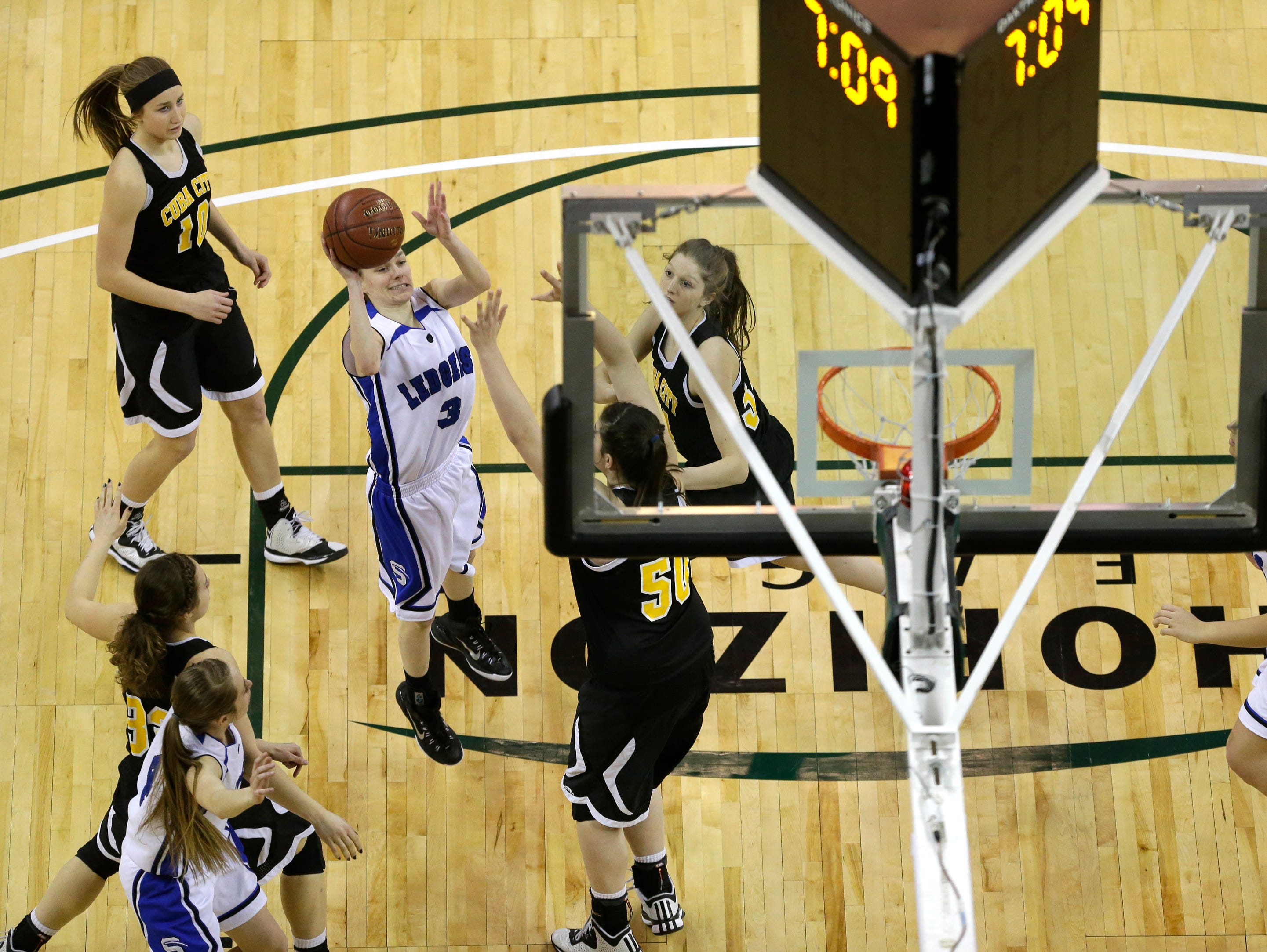 Saint Mary's Springs' Destiny Ottery puts up a shot against Cuba City during their WIAA Division 4 semifinal basketball game at the Resch Center in Ashwaubenon.