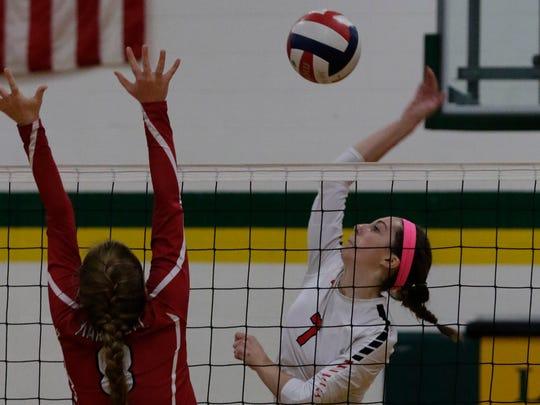 Oshkosh Lourdes' Rachel Aasby spikes the ball against