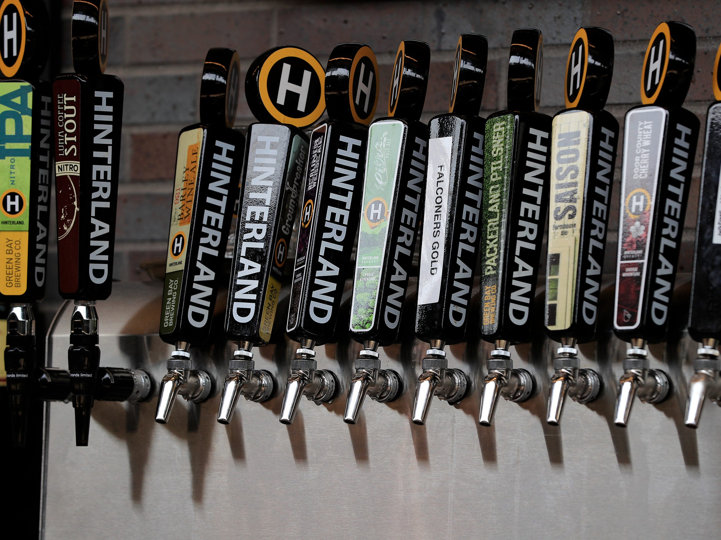 Taps of beer are shown at Hinterland Brewing on Thursday, June 8, 2017, in Ashwaubenon.