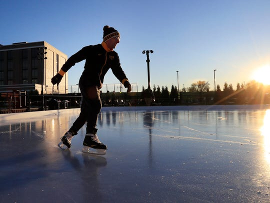 Anthony Renkas of De Pere skates on the ice skating pond Thursday in Titletown District in Ashwaubenon.