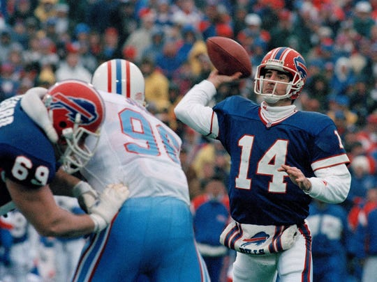 "Quarterback Frank Reich of the Buffalo Bills passes during the game against the Houston Oilers that has come to be known as ""The Comeback,"" at Rich Stadium in Orchard Park, N.Y., Jan. 3, 1993. The Bills, 32 points behind, came back to win in overtime, 41-38. The game holds the record for the largest comeback in the history of the NFL."