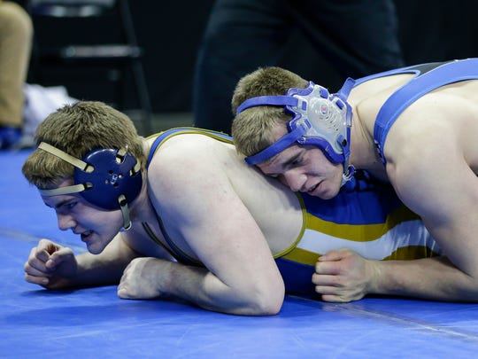 Winnebago Lutheran's Grant Manke battles it out with Aquinas' Jack Horihan in the D3 220-lb fifth place match during the WIAA Individual Wrestling State Tournament at the Kohl Center Saturday, Feb. 24, 2018, in Madison, Wis.
