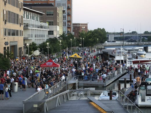 People fill up CityDeck, on the west side of the Watermark