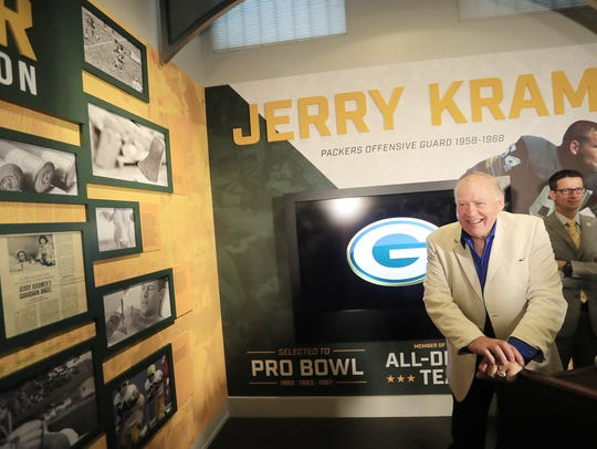 Jerry Kramer looks at photos displayed at the opening