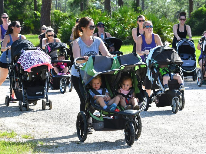 The moms and kids walking around Wickham Park, in