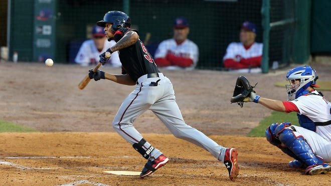Red Wings center fielder Byron Buxton easily beats out this bunt for a base hit against Buffalo on Wednesday. Buxton is the first No. 1 prospect to play for the Red Wings since 1990.