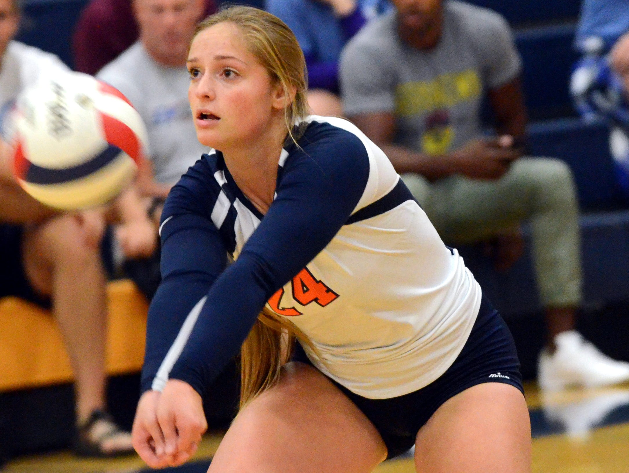 Beech High senior Saidee McDaniel passes a serve during the first game.