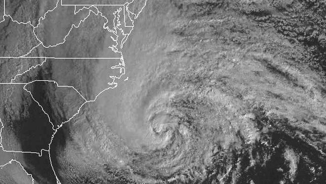In this satellite image from Oct. 28, 2012, massive Hurricane Sandy spins just off the east coast of the U.S.