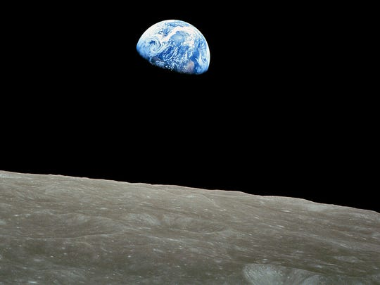 """This NASA image shows the first color image of the Earth taken by the Apollo 8 astronauts on December 24, 1968. Today, December 24, 2013 marks the 45th anniversary of the iconic Christmas Eve """"Earthrise"""" images.  AFP PHOTO / HO / NASAHO/AFP/Getty Images ORG XMIT: - ORIG FILE ID: 525634616"""