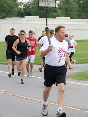 Bucyrus police Chief David Koepke leads the 2014 Ohio Law Enforcement Torch Run for the Special Olympics. The torch run will return to the city this Thursday.