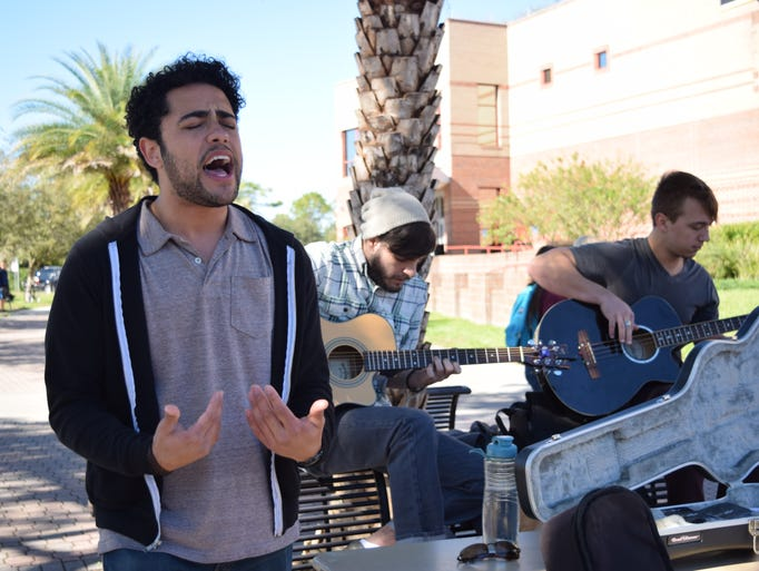 Miguel Larsen belts out a soulful tune with his band,