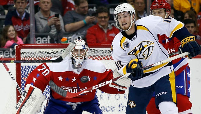 Capitals goalie Braden Holtby waits to block the puck as Predators center Colton Sissons attempts to deflect it, during the third period on Friday in Washington.