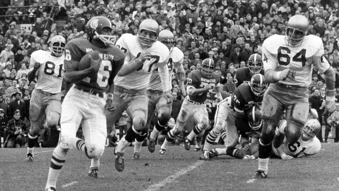 Michigan State's Jimmy Raye carries the ball against the Notre Dame defense during their historic game on Nov. 19, 1966 in East Lansing. The game finished in a 10-10 tie.