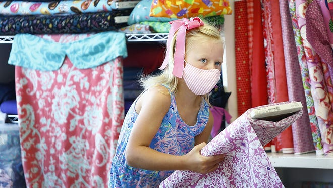 "Laken Carven-7 picks her fabric, she is from Scituate.  At the ""Makery"" in North Scituate kids learn how to sew. In todays class they are making their own face masks on September 9, 2020  Greg Derr/ The Patriot Ledger"