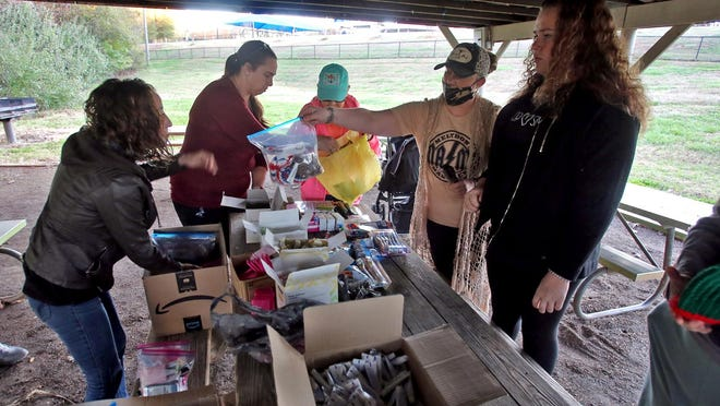 Volunteers pack health care items in bags for Cleveland County's homeless population.