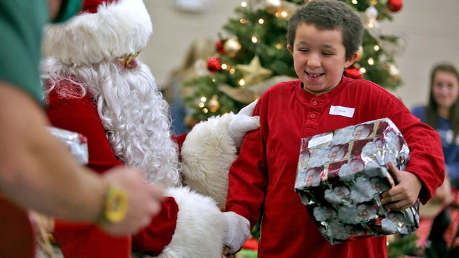 Jacob Harrill visits with Santa after a day full of games at a past North Shelby Christmas party.