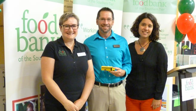 Wegmans shoppers in Hornell donated 10,804 pounds of food to the Fill the Bus campaign. Pictured from left are Jennifer Edger, director of community programs at the Food Bank; Mike Brewer of, Wegmans in Hornell; and Natasha Thompson, president and CEO of the Food Bank of the Southern Tier.