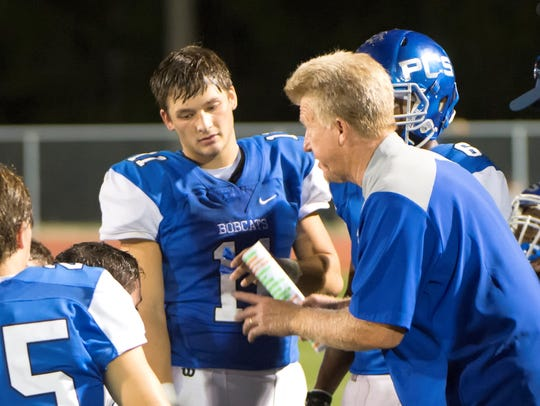 PCS coach Joey Hawkins talks to his players during