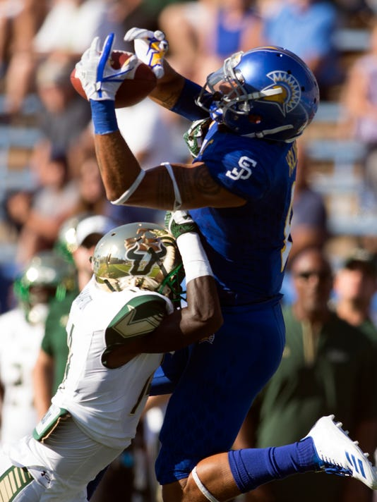 San Jose State wide receiver Justin Holmes, top, can't hold on to a deep pass over South Florida defender Mike Hampton during the first quarter of an NCAA college football game, Saturday, Aug. 26, 2017, in San Jose, Calif. (AP Photo/D. Ross Cameron)