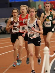 Corinne Barney is shown one her way to a seventh place finish in the 3,200 meters. Barney ran the event in 11:02 at the State Meet of Champions in Toms River. Sunday, February 26, 2017.