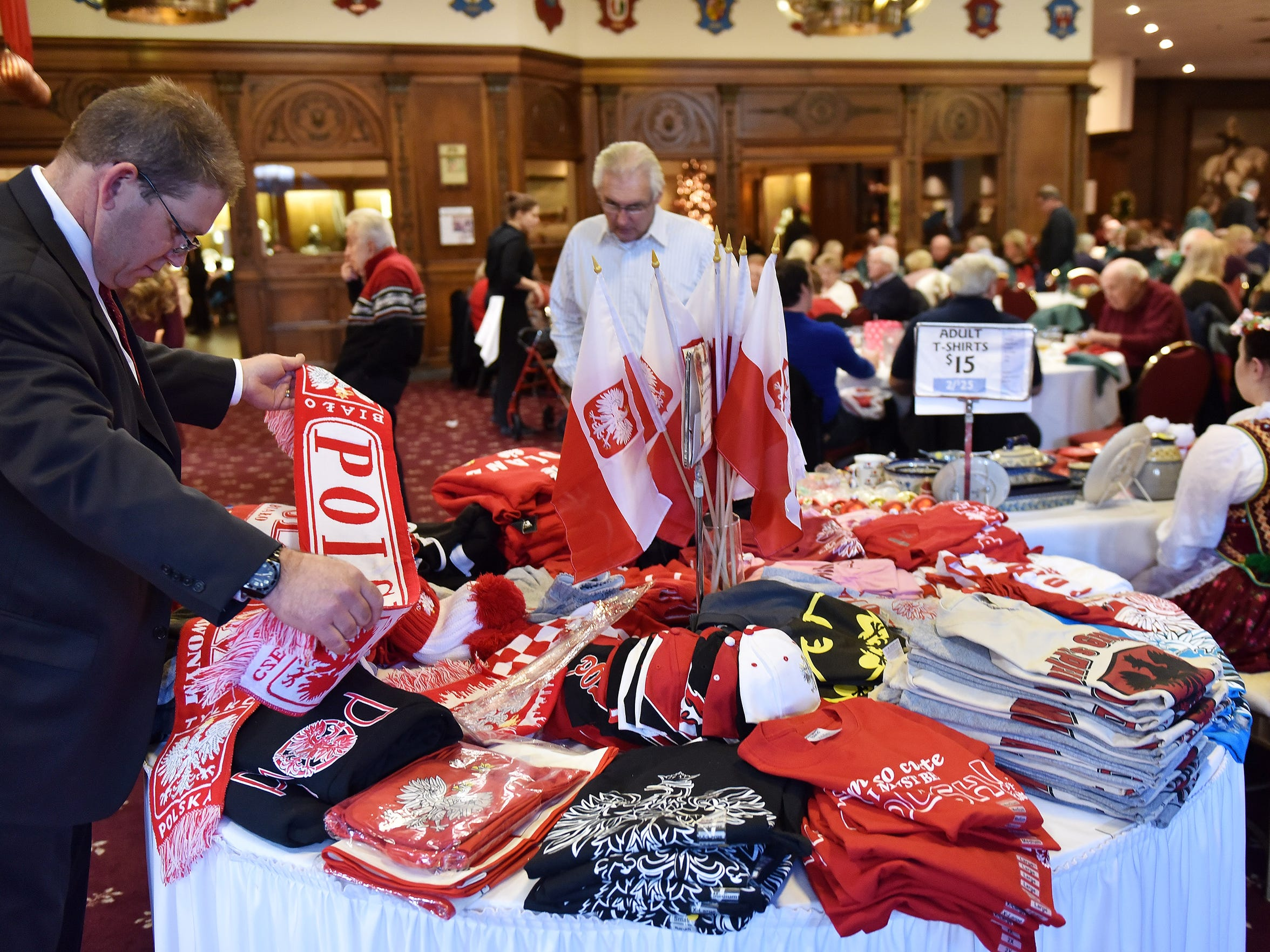 Geoff Kowalczyk of Sterling Heights looks at Polish scarves at a Polish American Cultural Center buffet.