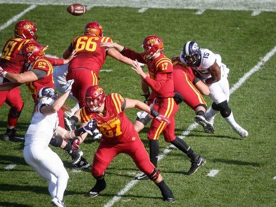 Iowa State quarterback Kyle Kempt fires a pass against