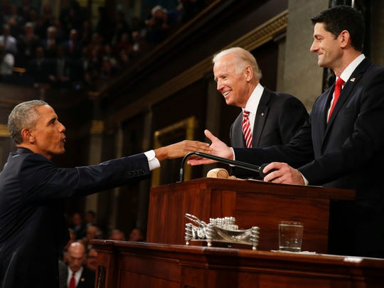 President Barack Obama shakes hands with House Speaker Paul Ryan of Wisconsin as Vice President Joe Biden watches before the State of the Union address to a joint session of Congress on Capitol Hill in Washington, Tuesday, Jan. 12, 2016. (AP Photo/Evan Vucci)