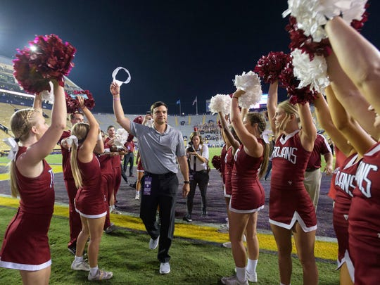 Troy head coach Neal Brown celebrates his team's 24-21