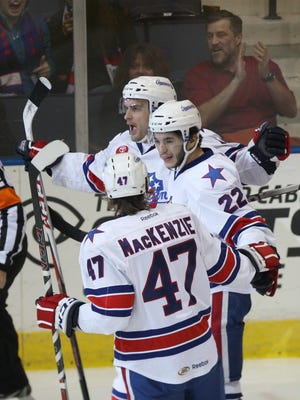 A file photo of the Amerks' Jamie Tardif celebrating with teammates.