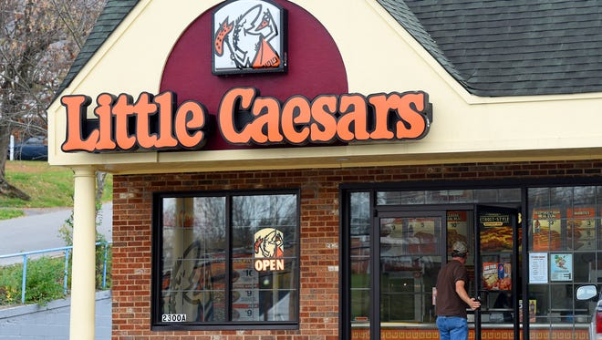 A customer enters Little Caesars located at 2300 West Beverley Street in Staunton on Wednesday afternoon, Nov. 18, 2015.