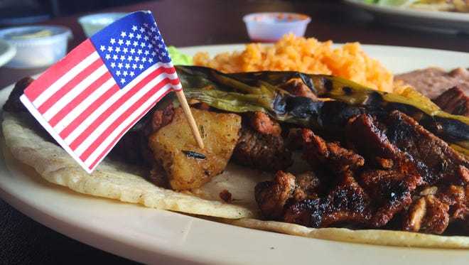 Tacos al carbon with al pastor pork, with sides of Spanish rice and beans ($9.99),