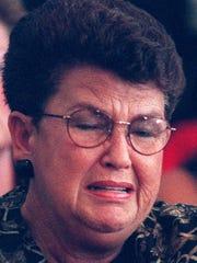 Joan Hicks Landwehr, sister of Fred Hicks, cries as