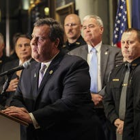 Republican presidential candidate, New Jersey Gov. Chris Christie answers questions after receiving an endorsment from members of Merrimack County law enforcement during a press conference at the Legislative Office Building in Concord, N.H., Monday, Nov. 30, 2015.  (AP Photo/Cheryl Senter)