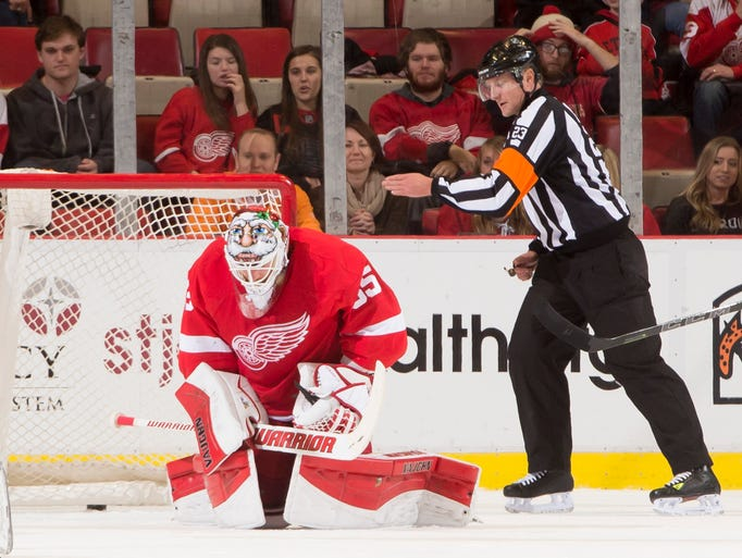 Detroit goalie Jimmy Howard reacts after letting in