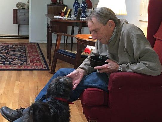 Warren Pollard pets Gracie, whom Pollard and his wife
