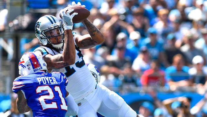 Carolina Panthers wide receiver Kelvin Benjamin (13) with the ball as Buffalo Bills free safety Jordan Poyer (21) defends in the first quarter at Bank of America Stadium.