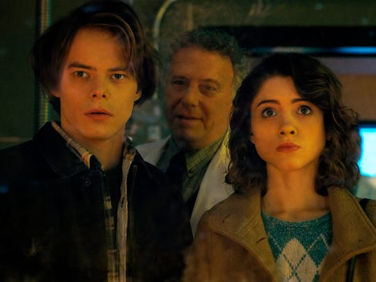 "Charlie Heaton, Paul Reiser and Natalia Dyer in a scene from Season 2 of the Netflix series, ""Stranger Things."" Reiser's character works for the government and is brought to town to clean up the mess left last season by Hawkins National Laboratory."
