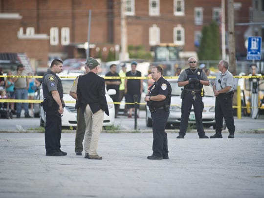 Vermont State police and local authorities guard the scene of a fatal shooting behind Barre City Place Friday night. A Vermont Department for Children and Families worker was shot and killed by a mother after loosing custody of her child, state officials say.