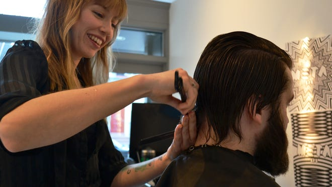 Dana Schlosser, left, cuts Chaus Davids' hair. Schlosser opened Meta Hair Studio at 15 S. Beaver St., York.