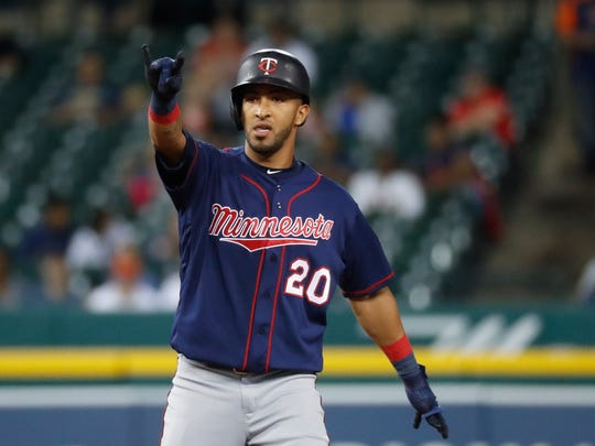 Minnesota Twins' Eddie Rosario celebrates hitting a two-run double in the seventh inning of a baseball game against the Detroit Tigers in Detroit, Tuesday, Sept. 24, 2019. (AP Photo/Paul Sancya)