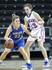Conner's Maddie Burcham keeps a close eye on NewCath's