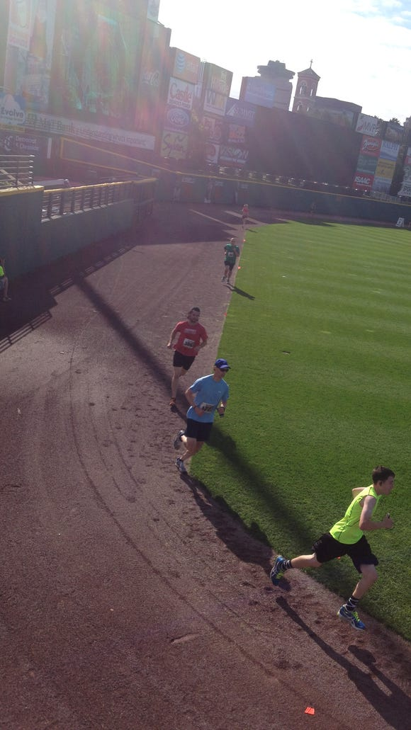 Running along the warning track at Frontier Field on the way to a 5K PR.
