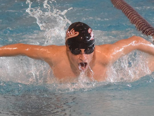 Pineville High School sophomore Ethan Coffey swims