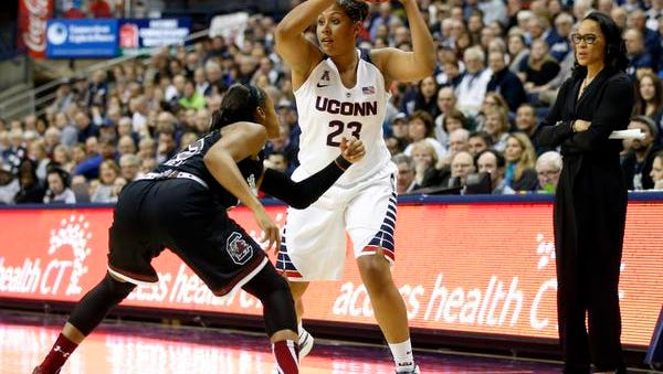 Feb 9, 2015; Storrs, CT, USA; Connecticut Huskies forward Kaleena Mosqueda-Lewis (23) looks for an opening against South Carolina Gamecocks guard Khadijah Sessions (5) in the second half at Harry A. Gampel Pavilion. UConn defeated South Carolina 87-62. Mandatory Credit: David Butler II-USA TODAY Sports