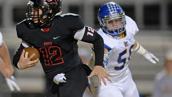 Hillcrest quarterback Collin Sneed (12) carries against Lexington during the 2nd round of the Class AAAA Division I playoffs Friday, November 21, 2014 at Hillcrest High.