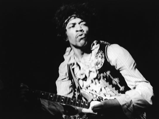 American rock guitarist Jimi Hendrix performing with