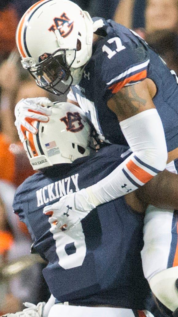 Auburn linebacker Cassanova McKinzy celebrates after intercepting the ball during Saturday's game with South Carolina.