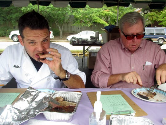 Aldo Dean, left, and Tom Prestigiacomo judge brisket at the ASBEE World Kosher BBQ Competition & Festival.